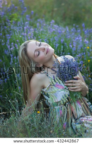 Portrait of the beautiful girl on lavender field
