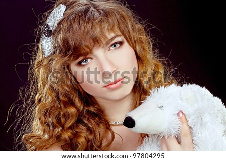 Portrait of the beautiful girl with red long ringlets hair isolated on black background - stock photo
