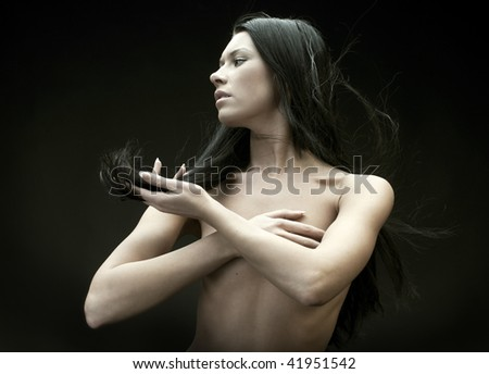 Portrait of the beautiful naked brunette with flying hair - stock photo
