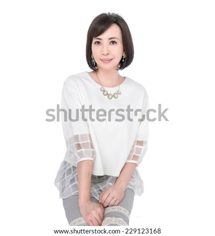 Portrait of the beautiful nice woman sitting - stock photo