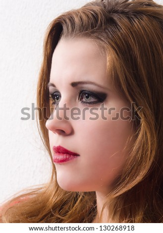 Portrait of the beautiful pale girl with long hair. - stock photo