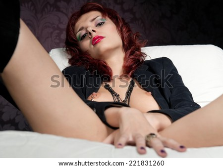 Portrait of the beautiful partially naked woman with red hair  - stock photo