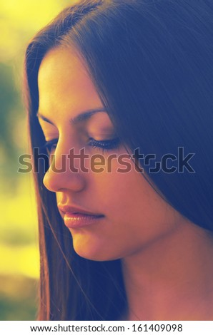 Portrait of the beautiful sad girl outdoor. - stock photo