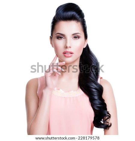 Portrait of the beautiful sensual woman with long brunette hair over white background. - stock photo