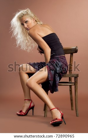 Portrait of the beautiful sexual girl of the blonde on brown background
