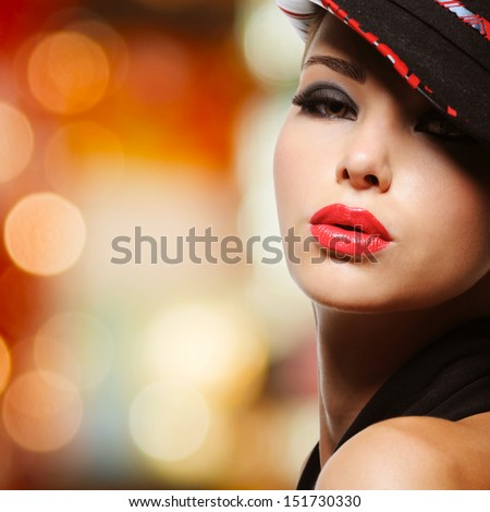 Portrait of the beautiful sexy woman with red lips in modern black hat - stock photo