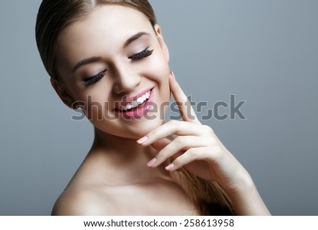 Portrait of the beautiful smiling woman - stock photo