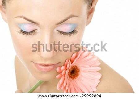 Portrait of the beautiful woman blindly and pink gerbera - stock photo