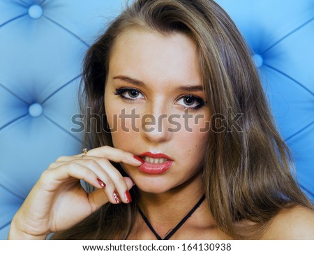Portrait of the beautiful woman in a black  dress - stock photo