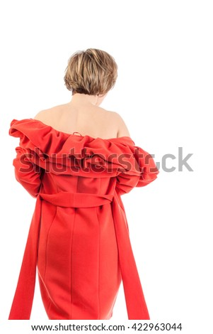 portrait of the beautiful woman in a red coat on a white background - stock photo