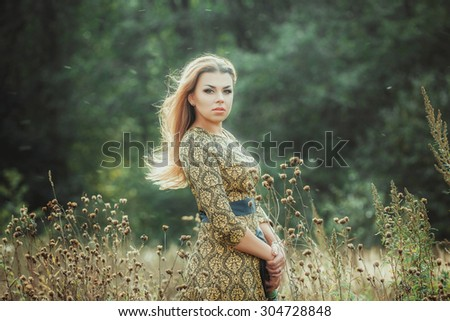 Portrait of the beautiful woman outdoors