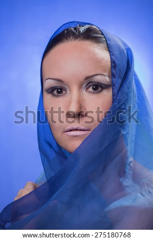 Portrait of the beautiful woman with a blue veil  - stock photo