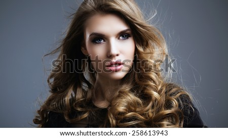 Portrait of the beautiful woman with blond hair