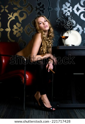 Portrait of the  beautiful woman with cigar - stock photo