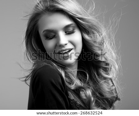 Portrait of the beautiful woman with delicate makeup - stock photo