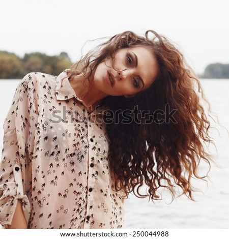Portrait of the beautiful young girl close-up, the wind fluttering hair - stock photo