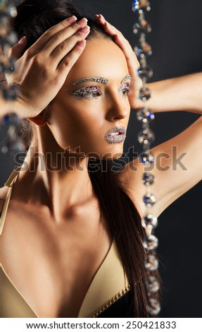 portrait of the beautiful young girl, whose person in jewels