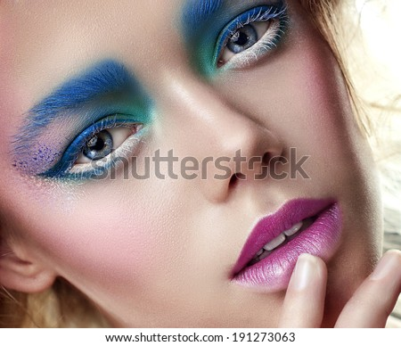 portrait of the beautiful young girl with shining skin and a beautiful make-up, color, paints, snow, cold, blossoming