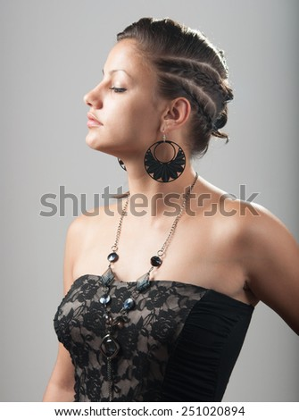 Portrait of the beautiful young lady isolated on gray background. - stock photo