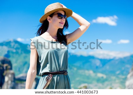portrait of the beautiful young woman looking at the splendid view in Greece