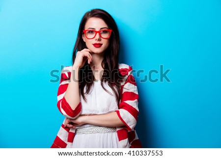 portrait of the beautiful young woman on the blue background