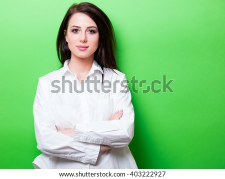 portrait of the beautiful young woman on the green background