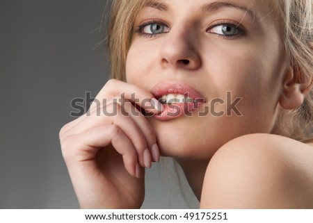 Portrait of the beautiful young woman with alluring glance