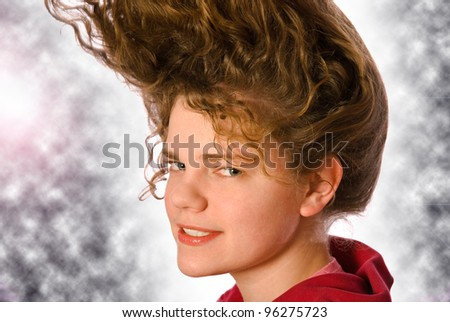 Portrait of the beautiful young woman with beauty long ringlets hairs