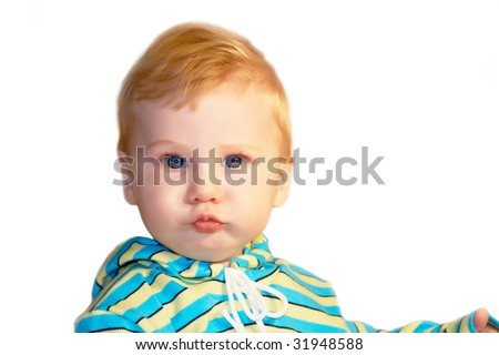 Portrait of the blond little boy on a background