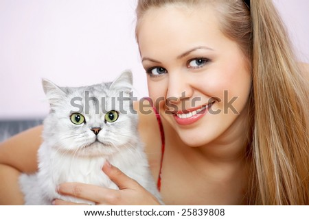Portrait of the blonde and cat, close up - stock photo