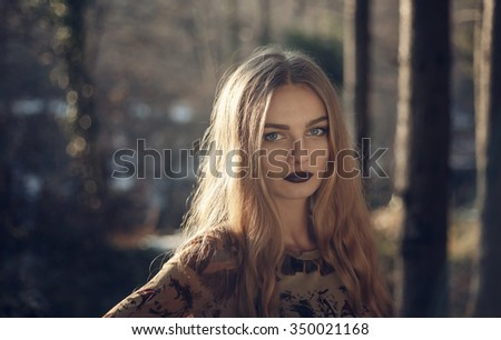 portrait of the blonde girl,blonde girl with green eyes, an unusually pretty face and long hair - stock photo