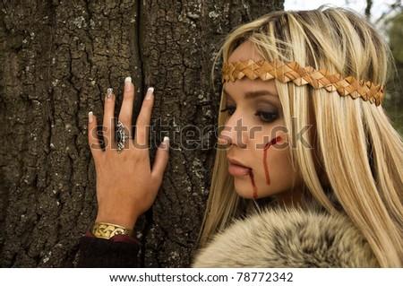 Portrait of the blonde girl in the Scandinavian suit - stock photo
