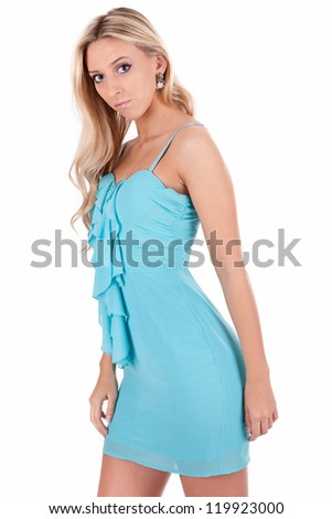 Portrait of the blonde in a turquoise dress - stock photo