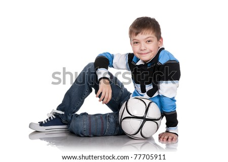 Portrait of the boy with a ball on a white background