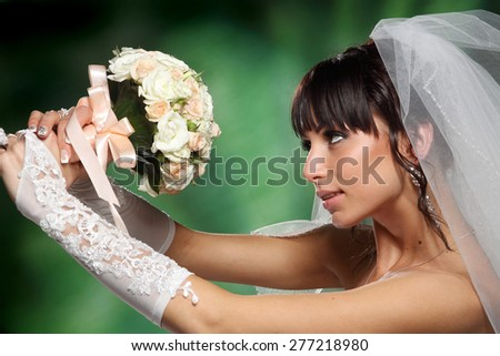 Portrait of the bride. nice view. fashion and makeup.good hairstyle. beautiful a bouquet - stock photo