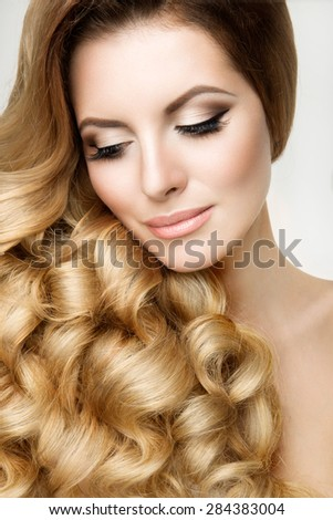 Portrait of the bride with big beautiful eyes on white background - stock photo