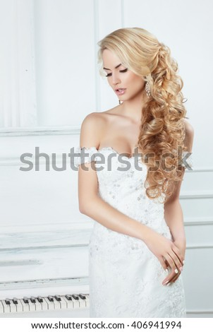 Portrait of the bride with long locks. In a white dress. - stock photo