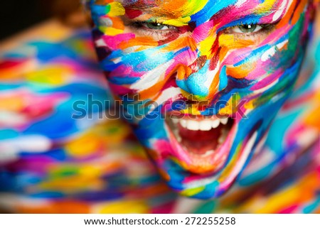 Portrait of the bright beautiful emotional woman with art make-up - stock photo