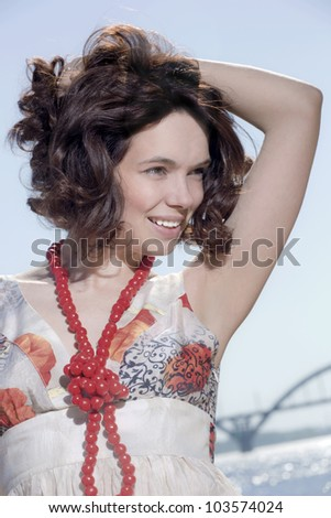 Portrait of the brunette against the river - stock photo