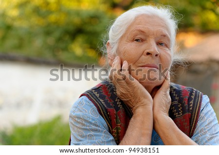 Portrait of the elderly woman. A photo on outdoors
