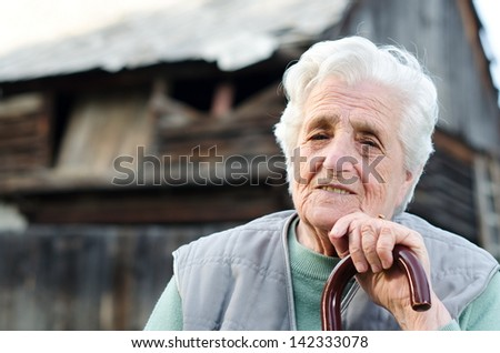 Portrait of the elderly woman. Outdoors - stock photo