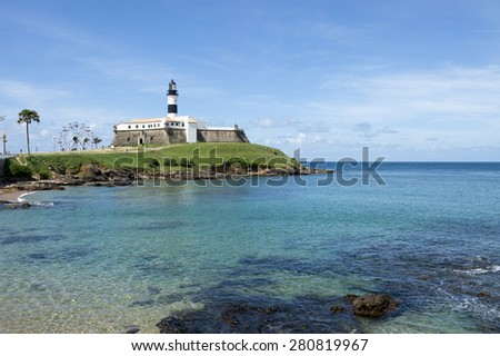 Portrait of the Farol da Barra lighthouse from the beach in Salvador Brazil