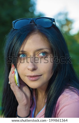 Portrait of the girl calling by phone - stock photo
