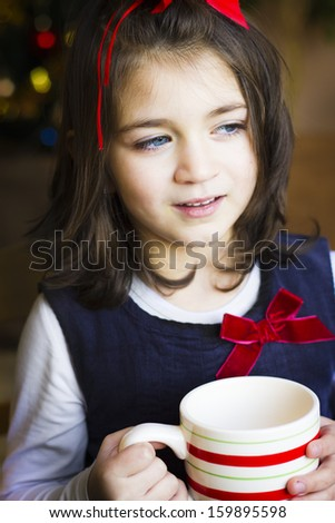 Portrait of the girl child drink from a cup  - stock photo