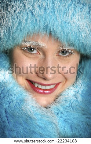 Portrait of the girl in a fur coat and hoarfrost on the face