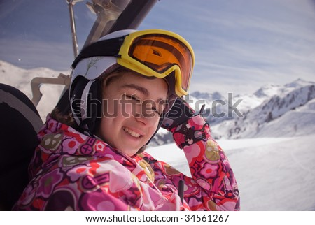 Portrait of the girl  in a mountain-skiing helmet and goggles - stock photo