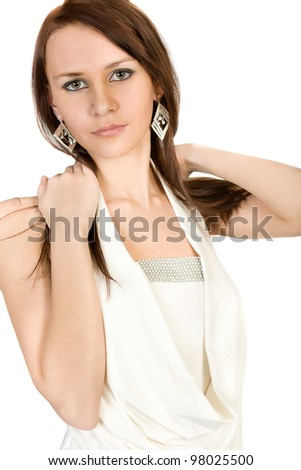 Portrait of the girl in a white blouse. Isolated on white