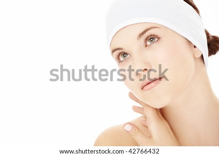 Portrait of the girl in the cosmetology bandage, isolated on a white background - stock photo