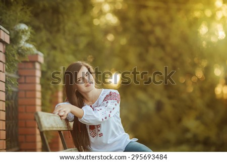 Portrait of the girl in the Ukrainian national clothes embroidery - stock photo