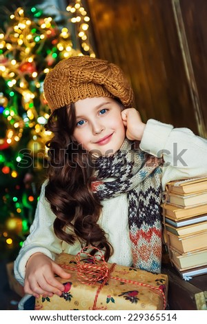 Portrait of the girl near christmas tree - stock photo